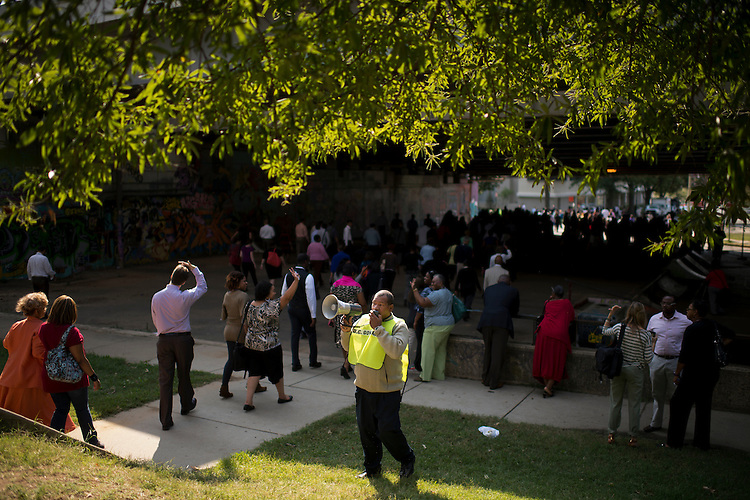 UNITED STATES - SEPTEMBER 27:  Workers make their way back to their office on 2nd Street, SE, after being a evacuated to Garfield Park on Capitol Hill during a fire drill.  (Photo By Tom Williams/CQ Roll Call)