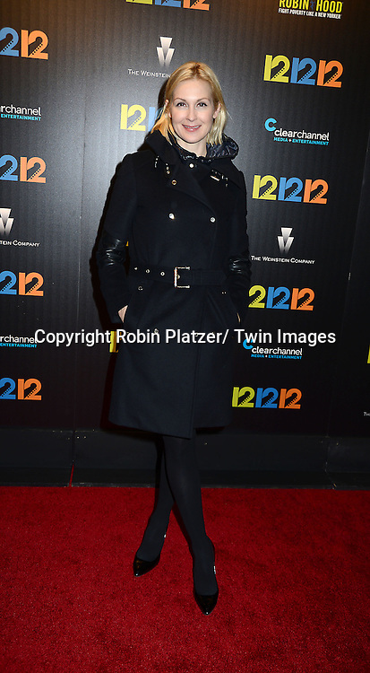"Kelly Rutherford attends the New York Premiere of ""12-12-12"" on November 8, 2013 at the Ziegfeld Theatrein New York City."