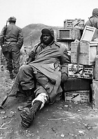 Pfc. Edward Wilson, 24th Inf. Regt., wounded in leg while engaged in action against the enemy forces near the front lines in Korea, waits to be evacuated to aid station behind the lines.  February 16, 1951. Pfc. Charles Fabiszak. (Army)<br /> NARA FILE #:  111-SC-358355<br /> WAR & CONFLICT #:  1394