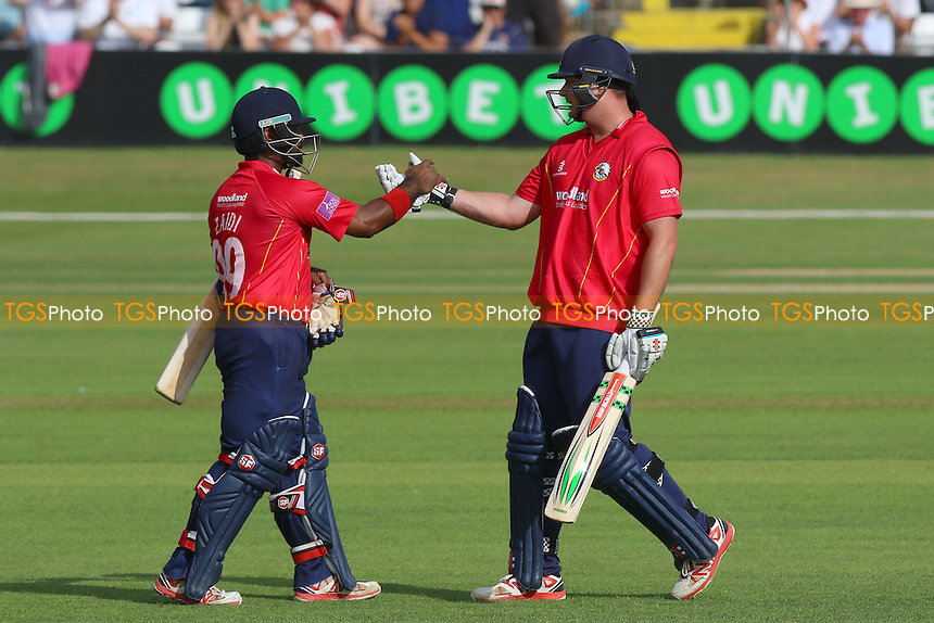 Jesse Ryder of Essex (R) celebrates scoring a century, 100 runs and is congratulated by Ashar Zaidi during Essex Eagles vs Surrey, Royal London One-Day Cup Cricket at the Essex County Ground on 24th July 2016