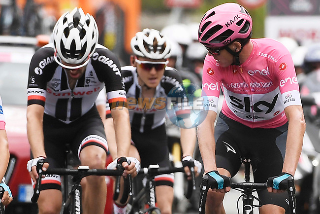 Race leader Chris Froome (GBR) Team Sky Maglia Rosa, Tom Dumoulin and Sam Oomen (NED) Team Sunweb climbing during Stage 20 of the 2018 Giro d'Italia, running 214km from Susa to Cervinia is the final mountain stage, with the last three climbs of Giro 101 deciding the GC of the Corsa Rosa, Italy. 26th May 2018.<br /> Picture: LaPresse/Fabio Ferrari   Cyclefile<br /> <br /> <br /> All photos usage must carry mandatory copyright credit (© Cyclefile   LaPresse/Fabio Ferrari)