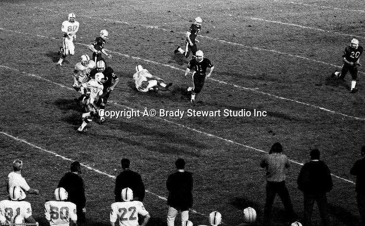 Bethel Park PA:  Offensive play with Chip Huggins 32 taking an option pitch and taking it down to the 10 yard line after good blocks by Dennis Franks 66 and Bob Hensler 77.  Chip had tremendous speed and determination. Others in the photo; Bruce Evanovich 80. The offense and defense played very well in the 14-0 victory over Canon McMillan.  The defensive unit was one of the best in Bethel Park history only allowing a little over 7 points a game.