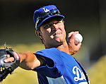 22 July 2011: Los Angeles Dodgers Manager Don Mattingly tosses some ball prior to a game against the Washington Nationals at Dodger Stadium in Los Angeles, California. The Nationals defeated the Dodgers 7-2 in their first meeting of the 2011 season. Mandatory Credit: Ed Wolfstein Photo