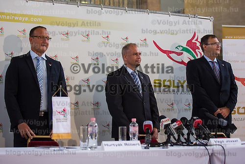 Jozsef Vago (C) CEO of Solyom Airways and his two partners Robert Hurtyak (L) and Janos Lucsik (R) attend a press conference of the newly founded airline company in Budapest, Hungary on July 24, 2013. ATTILA VOLGYI