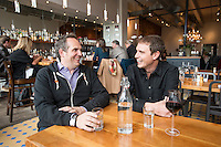 """Kimbal Musk (cq, right) and Chef Hugo Matheson (cq) at The Kitchen in Boulder, Colorado, Friday, March 13, 2015. Musk is CEO of The Kitchen restaurant group, with its flagship in Boulder. It is a """"farm-to-table"""" restaurant serving good food at decent prices. Musk also heads Learning Gardens, a non-profit that puts classroom-size gardens in schools so kids can center a curriculum around growing food.  <br /> <br /> Photo by Matt Nager"""