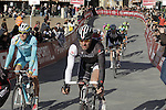Riders including Jens Voigt (GER) Trek Factory Racing cross the finish line on Il Campo in Siena at the end of the 2014 Strade Bianche race over the white dusty gravel roads of Tuscany running 200km from San Gimignano to Siena, Italy. 8th March 2014.<br /> Picture: Eoin Clarke www.newsfile.ie