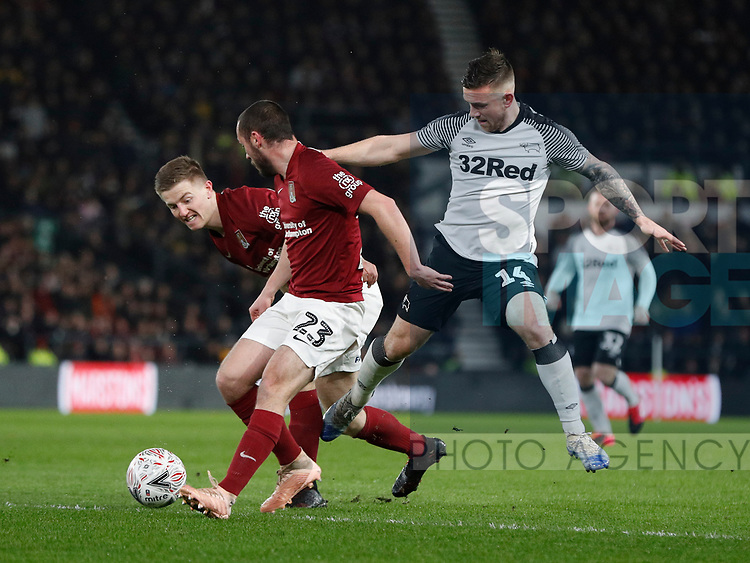 Jack Marriott of Derby County tackles Michael Harriman of Northampton during the FA Cup match at the Pride Park Stadium, Derby. Picture date: 4th February 2020. Picture credit should read: Darren Staples/Sportimage