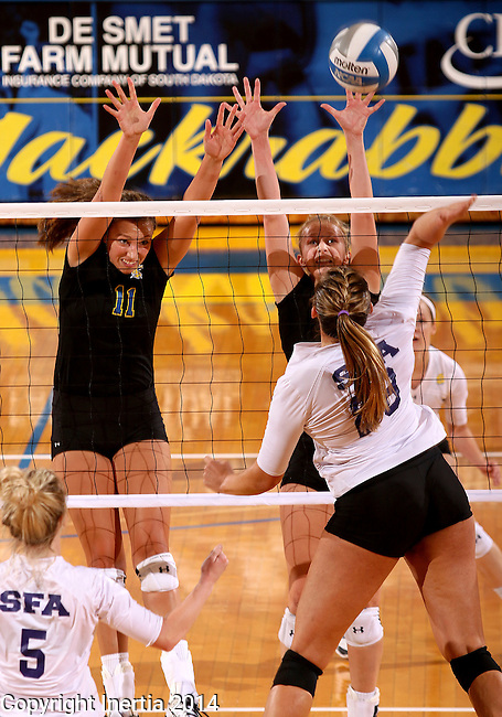 BROOKINGS, SD - SEPTEMBER 5:  Wagner Larson #11 and Margit Hansing #4  from South Dakota State double team for a block against Tori Bates #28 from Stephen F. Austin during their match Friday afternoon at Frost Arena in Brookings. (Photo/Dave Eggen/Inertia)