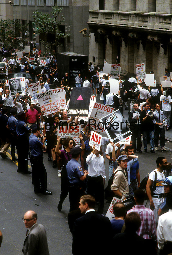 The activist group ACT UP (AIDS Coalition to Unleash Power) protests the high cost of AIDS treatment drugs in front of the New York Stock Exchange on September 14, 1989. (© Frances M. Roberts)
