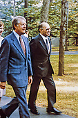 United States President Jimmy Carter and Prime Minister Menachem Begin of Israel stroll along the paths of Camp David upon Begin's arrival for the Mid-East Summit at Camp David, the presidential retreat near Thurmont, Maryland prior to their meeting on September 6, 1978..Credit: White House via CNP