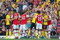 José Holebas of Watford & Mattéo Guendouzi of Arsenal are held apart during the Premier League match between Watford and Arsenal at Vicarage Road, Watford, England on 16 September 2019. Photo by Andy Rowland.