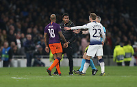 Manchester City's Fabian Delph and Tottenham Hotspur's Christian Eriksen confront a pitch invader<br /> <br /> Photographer Rob Newell/CameraSport<br /> <br /> UEFA Champions League Quarter-finals 1st Leg - Tottenham Hotspur v Manchester City - Tuesday 9th April 2019 - White Hart Lane - London<br />  <br /> World Copyright © 2018 CameraSport. All rights reserved. 43 Linden Ave. Countesthorpe. Leicester. England. LE8 5PG - Tel: +44 (0) 116 277 4147 - admin@camerasport.com - www.camerasport.com