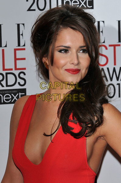 CHERYL COLE.The ELLE Style Awards 2011 at Grand Connaught Rooms, London, England..February 14th, 2011 .headshot portrait red sleeveless low cut cleavage lipstick make-up beauty smiling .CAP/PL.©Phil Loftus/Capital Pictures.
