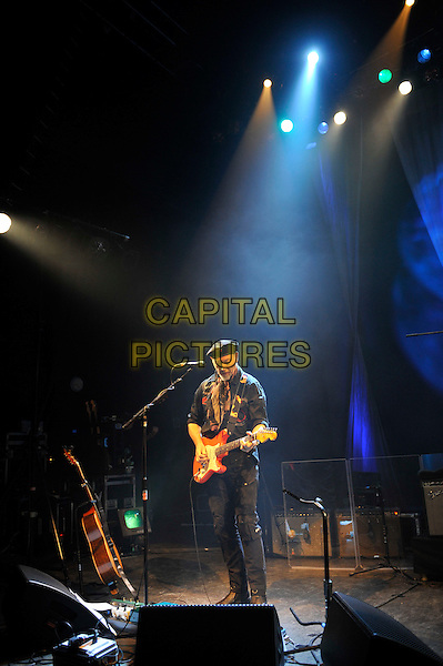 Richard Thompson.performing in concert, Shepherd's Bush Empire, London, England. .25th February 2013.on stage lie gig performance music full length hat flat cap scarf black shirt trousers guitar goatee facial hair .CAP/MAR.© Martin Harris/Capital Pictures.