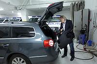 Police officer Morten Haukeland puts abulletproof vest in his unmarked police car before starting a patrol.<br /> <br /> Morten Haukeland legger en skuddsikker vest i bilen.  Sentrum Politistasjons etteretningsavdeling følger med på utelivet i Oslo sentrum. . (Foto:Fredrik Naumann/Felix Features)