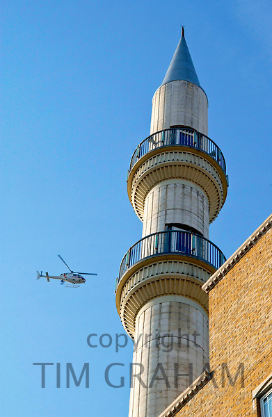 A POLICE HELICOPTER IS CIRCLING THE SULEYMANIYE MOSQUE, A TURKISH ISLAMIC CULTURAL CENTRE IN EAST LONDON.
