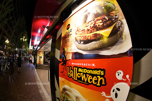 "McDonal's Japan launches a black burger called ""Ikasumi (Squid Ink) burger"" and white burger ""Camembert Chicken Fireo"" for Halloween season on October 4, 2014 in Tokyo Japan. The Ikasumi burger contains black sesame and squid ink on its buns, and fried onions, cheddar cheese, squid ink and chipotle sauce. The concept of the burger is ""what would happen if witch played a trick on the burger."" The burgers are currently available at three branches in Tokyo's Shinjuku area: Shinjuku Minamiguchi, Seibu Shinjuku Station and Shinjuku Oguard Nishi and are priced at 370 JPY (3.35USD) and 670JPY (6.06USD) for the combo. McDonald's Japan announced on their official website that they will expand the sales to other stores from October 8. (Photo by Rodrigo Reyes Marin/AFLO)"