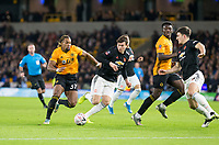 4th January 2020; Molineux Stadium, Wolverhampton, West Midlands, England; English FA Cup Football, Wolverhampton Wanderers versus Manchester United; Adama Traore of Wolverhampton Wanderers with the ball at his feet as Victor Lindelof of Manchester United comes in to tackle for the ball - Strictly Editorial Use Only. No use with unauthorized audio, video, data, fixture lists, club/league logos or 'live' services. Online in-match use limited to 120 images, no video emulation. No use in betting, games or single club/league/player publications