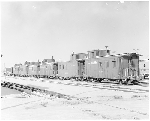 Line of 6 cabooses with #0584, #0586 &amp; #0574 numbers visible.  Dual gauge track.<br /> D&amp;RGW