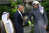 United States President Barack Obama encourages Kuwaiti Emir Sheikh Sabah Al-Ahmad Al-Sabah (L) to make a statement alongside Qatar's Emir Sheikh Tamim bin Hamad Al-Thani, following the Gulf Cooperation Council-U.S. summit at Camp David on May 14, 2015. Obama hosted leaders from Saudi Arabia, Kuwait, Bahrain, Qatar, the United Arab Emirates and Oman to discuss a range of issues including terrorism and the U.S.-Iran nuclear deal. <br /> Credit: Kevin Dietsch / Pool via CNP
