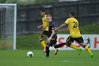 Team Wellington's Oliver Bassett looks for support as Wellington Phoenix's Ahmed Othman closes in during the ISPS Handa Premiership football match between Team Wellington and Wellington Phoenix Reserves at David Farrington Park in Wellington, New Zealand on Sunday, 17 November 2019. Photo: Dave Lintott / lintottphoto.co.nz