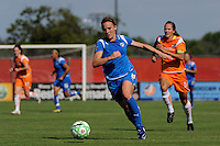 Amy Rodriguez (8) of the Boston Breakers is trailed by Keeley Dowling (17) of Sky Blue FC. Sky Blue FC defeated the Boston Breakers 1-0 during a Women's Professional Soccer match at Yurcak Field in Piscataway, NJ, on July 4, 2009.