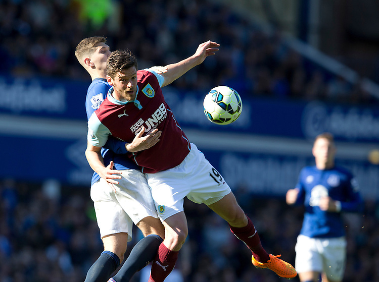 Burnley's Lukas Jutkiewicz battles with Everton's John Stones<br /> <br /> Photographer Stephen White/CameraSport<br /> <br /> Football - Barclays Premiership - Everton v Burnley - Saturday 18th April 2015 - Goodison Park - Everton<br /> <br /> &copy; CameraSport - 43 Linden Ave. Countesthorpe. Leicester. England. LE8 5PG - Tel: +44 (0) 116 277 4147 - admin@camerasport.com - www.camerasport.com