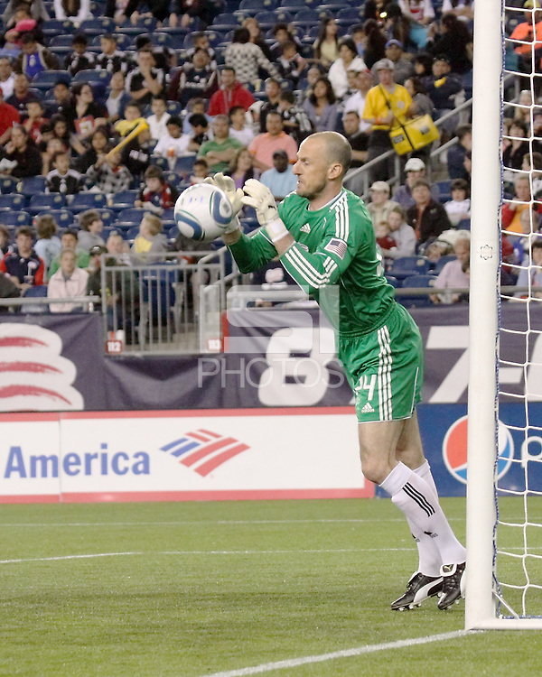 New England Revolution goalkeeper Preston Burpo (24) saves a goal during a free kick.  The New England Revolution drew FC Dallas 1-1, at Gillette Stadium on May 1, 2010