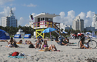 People enyoying the sun sand of South Beach, Miami Beach Florida.