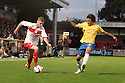 Robbie Rogers of Stevenage takes on Tadanari Lee of Southampton. Stevenage v Southampton - Capital One Cup Second Round - Lamex Stadium, Stevenage - 28th August, 2012. © Kevin Coleman 2012