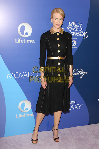 Nicole Kidman<br /> at Variety's 5th Annual Power of Women event presented by Lifetime at the Beverly Wilshire Four Seasons Hotel in Beverly Hills, California, USA, October 4th 2013.<br /> full length black leather gold dress coat buttons belt collar strappy sandals<br /> CAP/MPI/mpi25<br /> &copy;mpi25/MediaPunch/Capital Pictures