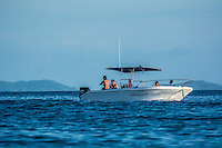 Namotu Island Resort, Fiji. Sunday February 8 2015) Ben Dunsmore's mates in the baot they hired from the mainland. Cloudbreak- The surf  this morning was in the 4'- 6' range. Cloudbreak was the pick spot but Restaurants was also breaking in the 3' range.  Photo: joliphotos.com