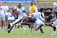 30 October 2010:  FIU running back Kedrick Rhodes (9) evades Florida Atlantic linebacker David Hinds (11) in the second quarter as the Florida Atlantic University Owls defeated the FIU Golden Panthers, 21-9, at Lockhart Stadium in Fort Lauderdale, Florida.