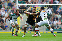 Billy Vunipola of London Wasps is tackled by James Johnston of Harlequins (right) as Olly Kohn of Harlequins looks onduring the Aviva Premiership match between London Wasps and Harlequins at Twickenham on Saturday 1st September 2012 (Photo by Rob Munro).