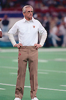 NEW ORLEANS, LA - Head coach George Seifert of the San Francisco 49ers stands on the field before Super Bowl XXIV against the Denver Broncos at the Superdome in New Orleans, Louisiana in January of 1990. Photo by Brad Mangin.