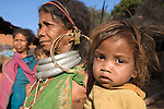 "FEBRUARY 12 & 13, 2009 : GADABA VILLAGE IN SOUTHWESTERN ORISSA. BONDAS, GADABAS , TRIBALS COME FROM THE HILLS FOR THE THURSDAY MARKET IN ONUKUDELLI, SOUTH OF JEYPORE IN WESTERN ORISSA. THIS IS PART OF INDIA'S TRIBAL BELT. THE BONDA  OR BONDO ARE AN ANCIENT TRIBE OF PEOPLE NUMBERING APPROX 5000 WHO LIVE IN THE ISOLATED HILL REGION OF SOUTHWEST ORISSA, THE BONDA ARE A SCHEDULED TRIBE IN INDIA AND ARE ALSO KNOWN AS REMO (MEANING ""PEOPLE"" IN BONDA LANGUAGE). THE TRIBE IS THE OLDEST AND MOST PRIMITIVE IN MAINLAND INDIA AND THEIR CULTURE HAS LITTLE CHANGED IN OVER THOUSAND YEARS. THEIR ISOLATION AND AGGRESSION PRESERVED THEIR CULTURE DESPITE THE PRESSURE OF AN EXPENDING INDIAN POPULATION. WOMEN WEAR THICK SILVER NECKLACE BANDS AND LONG COLORFUL NECKLACES MADE OF BEADS."