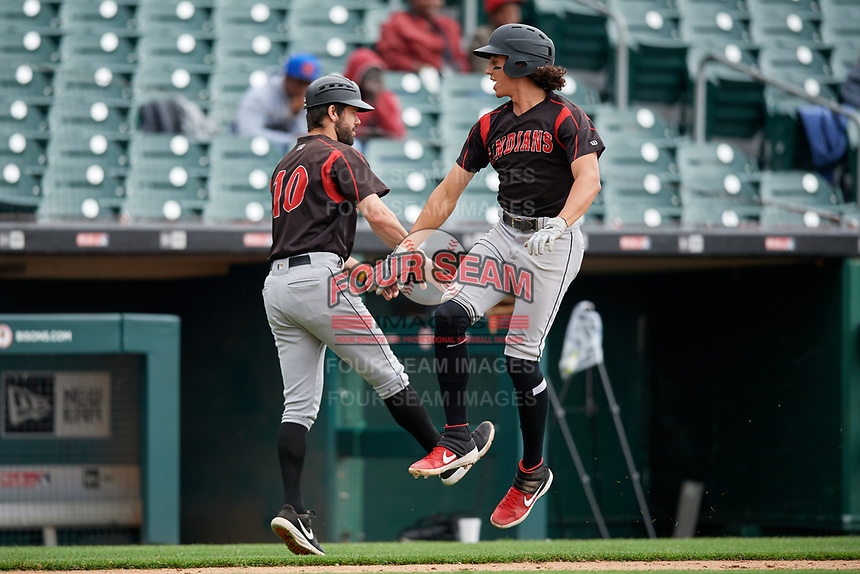Indianapolis Indians Cole Tucker (27) low fives coach Jonathan Schwind (10) after hitting a home run during an International League game against the Buffalo Bisons on June 20, 2019 at Sahlen Field in Buffalo, New York.  Buffalo defeated Indianapolis 11-8  (Mike Janes/Four Seam Images)