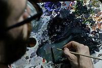 Colombian artist Roberto Montoya works on the Hi-Fi series paintings, at his studio in New York. 10,18,2014. Photo by Eduardo Munoz Alvarez / VIEWpress