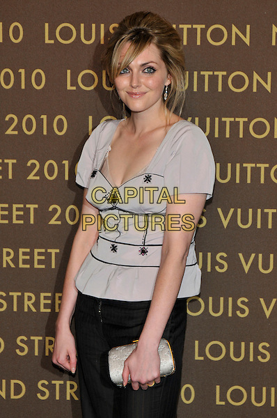 SOPHIE DAHL .attends the launch of the Louis Vuitton Bond Street Maison in London, England, UK, May 25th, 2010. .half length grey gray top blouse black  clutch bag gold fringe hair up .CAP/PL.©Phil Loftus/Capital Pictures.