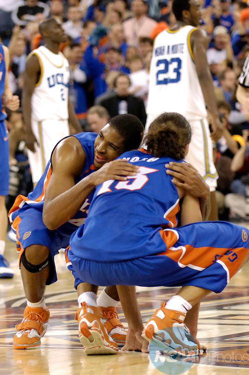 3 APR 2006: Adrian Moss (4) of the University of Florida hugs teammate Joakim Noah (13) as the final seconds tick off the clock during the Division I Men's Final Four Championship Game held at the RCA Dome in Indianapolis, IN. The University of Flordia Gators defeated the UCLA Bruins 73-57 for the national title. Ryan McKee/NCAA Photos
