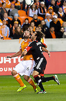 Adam Moffat of the Dynamo and Dejan Jakovic of D.C United tussle for the ball at BBVA Compass Stadium. Houston beat D.C United, 2-0 in the MLS season opener.