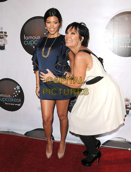 KOURTNEY KARDASHIAN & KRIS JENNER .at The Famous Cupcakes Beverly Hills Grand Opening, Beverly Hills, California, USA, October 7th,2009..full length hand on hip gold necklace ruffles ruffle pregnant maternity  mini side  blue dress navy beige shoes heels pointy platform mom mum  mother daughter white hand on bump tights patent .CAP/DVS.©DVS/RockinExposures/Capital Pictures.