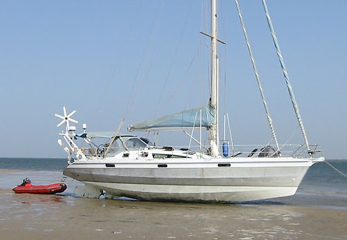 Ovni 435 beached. All ballast is internal, and the centreboard retracts completely, while the rudder is hydraulically swivelled to align with the underside of the boat