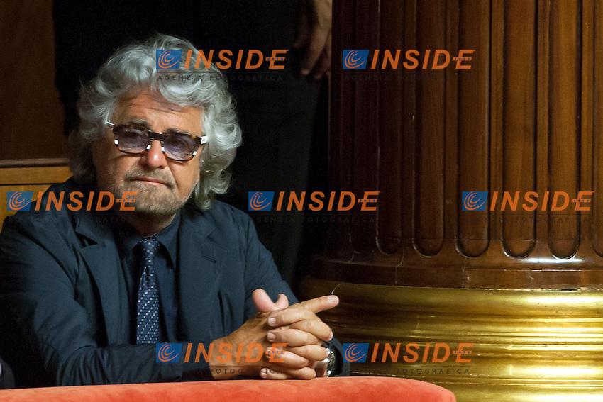 Beppe Grillo con i suoi occhiali autofirmati<br /> Roma 15-07-2014 Senato Aula. Disposizioni per il superamento del bicameralismo paritario, la riduzione del numero dei parlamentari, il contenimento dei costi di funzionamento delle istituzioni, la soppressione del CNEL e la revisione del Titolo V della parte seconda della Costituzione.<br /> Photo Samantha Zucchi Insidefoto