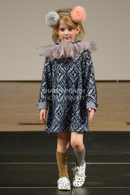 Model walks runway in an outfit by Condor, during the petitePARADE Children's Club fashion show at the Jacob Javits Center in New York City, on January 9, 2016.