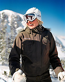 USA, Utah, happy young woman in ski gear, Alta Ski Resort