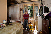 Kraljevo - Collective Center. Gajic family arrived in 1999 from Klina - Kosovo. The center will close in a month and this man has not yet found a solution. He lives with two brothers, his grandmother who is blind and his mother, infirm in bed (the woman lying in bed on the left).