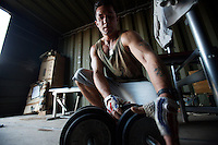 An Italian soldier from the 8th Bersaglieri regiment of the italian ESERCITO lifts weights  in the UNIFIL Chama base in Southern Lebanon on Friday Dec 08 2006..Close to 1000 Italian peacekeepers operate in  the in Southern lebanon town of Chama, constantly patrolling their sector in search for illegal weapons in the country.