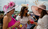 LOUISVILLE, KY - MAY 04: Three women dress in their Oaks day finest and drink Kentucky Oaks Lillies on Kentucky Oaks Day at Churchill Downs on May 4, 2018 in Louisville, Kentucky. (Photo by Scott Serio/Eclipse Sportswire/Getty Images)