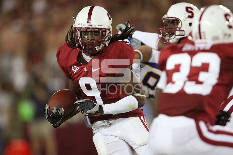 STANFORD, CA - SEPTEMBER 19:  Richard Sherman of the Stanford Cardinal returns a punt 48 yards for a touchdown during Stanford's 42-17 win over the San Jose State Spartans at Stanford Stadium on September 19, 2009 in Stanford, California.